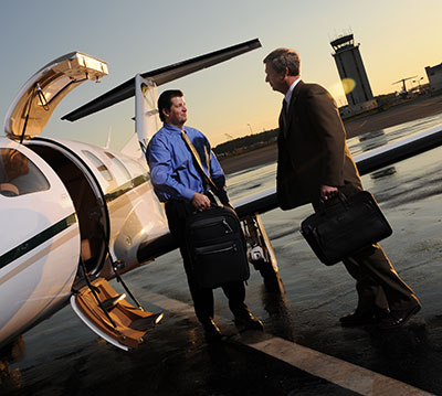 business traveler boarding jet